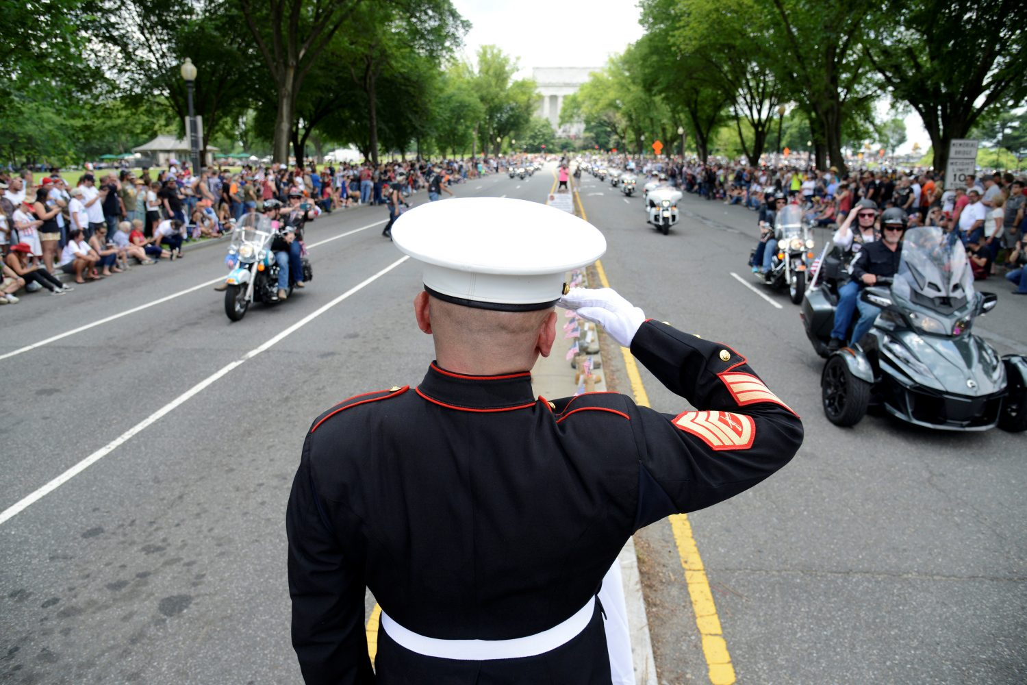 "USMC Staff Sgt. Tim Chambers (ret.) salutes motorcycle riders as they pass by during the 32nd Annual, and possibly final, Rolling Thunder ""Ride for Freedom"" during Memorial Day weekend to support veterans and call attention to POWs and MIAs, in Washington, U.S., May 26, 2019.REUTERS/Mike Theiler"