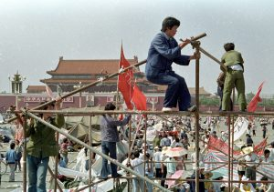 FILE PHOTO: Student protesters construct a tent to protect them from the elements in Tiananmen Square in Beijing, China, May 26, 1989. REUTERS/Shunsuke Akatsuka/File Photo