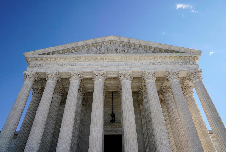FILE PHOTO: The Supreme Court stands in Washington, U.S., February 15, 2019. REUTERS/Joshua Roberts/File Photo