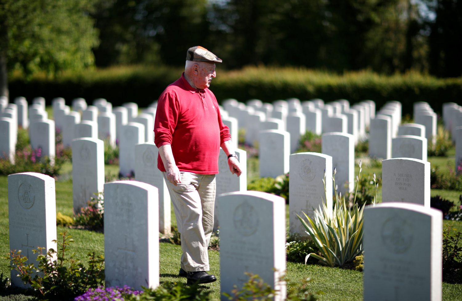 Yves Faucon, 86, from Tilly-sur-Seulle in the Normandie region visits his town's military cemetery as he attends an interview with Reuters in Tilly-sur-Seulle, France, May 14, 2019. REUTERS/Christian Hartmann