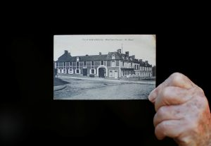 Yves Faucon, 86, from Tilly-sur-Seulle in the Normandie region shows a photograph of his mother's hotel in downtown Tilly, which was destroyed during operationsÊafter D-Day, as he attends an interview with Reuters in Tilly-sur-Seulle, France, May 14, 2019. REUTERS/Christian Hartmann