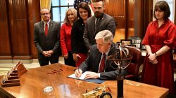 FILE PHOTO - Missouri Governor Mike Parson signs Bill 126 into law banning abortion beginning in the eighth week of pregnancy, alongside state House and Senate members and pro-life coalition leaders at his office in Jefferson City, Missouri, U.S., May 24, 2019. Office of Governor Michael L. Parson/Handout via REUTERS.