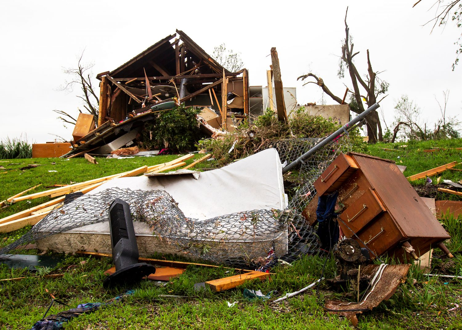 A mattress and dresser drawer are among the debris scattered on a lawn near a damaged house after several tornadoes reportedly touched down, in Linwood, Kansas, U.S., May 29, 2019. REUTERS/Nate Chute