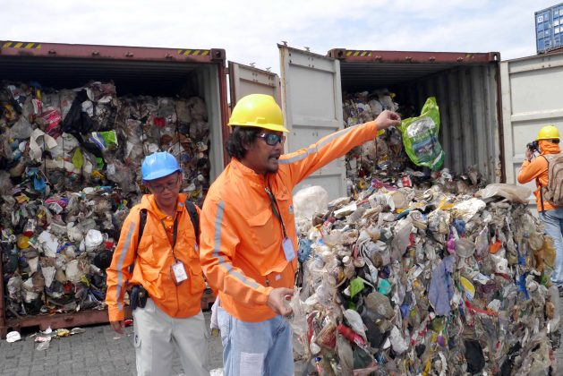 Philippine customs officials inspect cargo containers containing tonnes of garbage shipped by Canada at Manila port November 10, 2014. Mandatory credit BAN Toxics/Handout via REUTERS