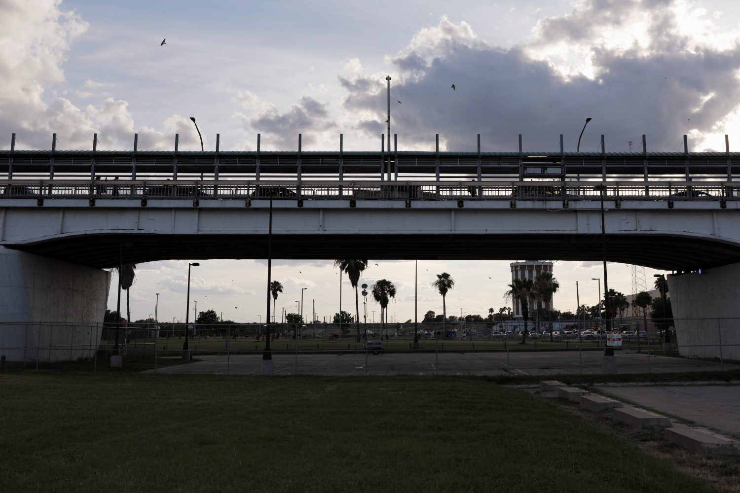 Vehicles and people cross the border bridge into the U.S., as seen from Laredo, Texas June 2, 2019. REUTERS/Carlos Jasso