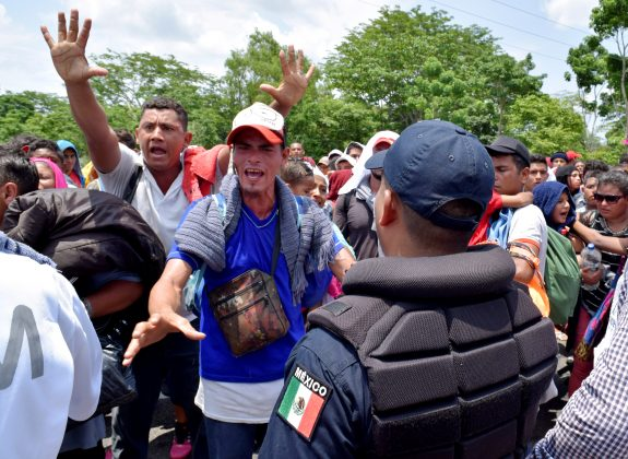 Migrants gesture while arguing with a federal police officer during a joint operation by the Mexican government to stop a caravan of Central American migrants on their way to the U.S., at Metapa de Dominguez, in Chiapas state, Mexico June 5, 2019. REUTERS/Jose Torres