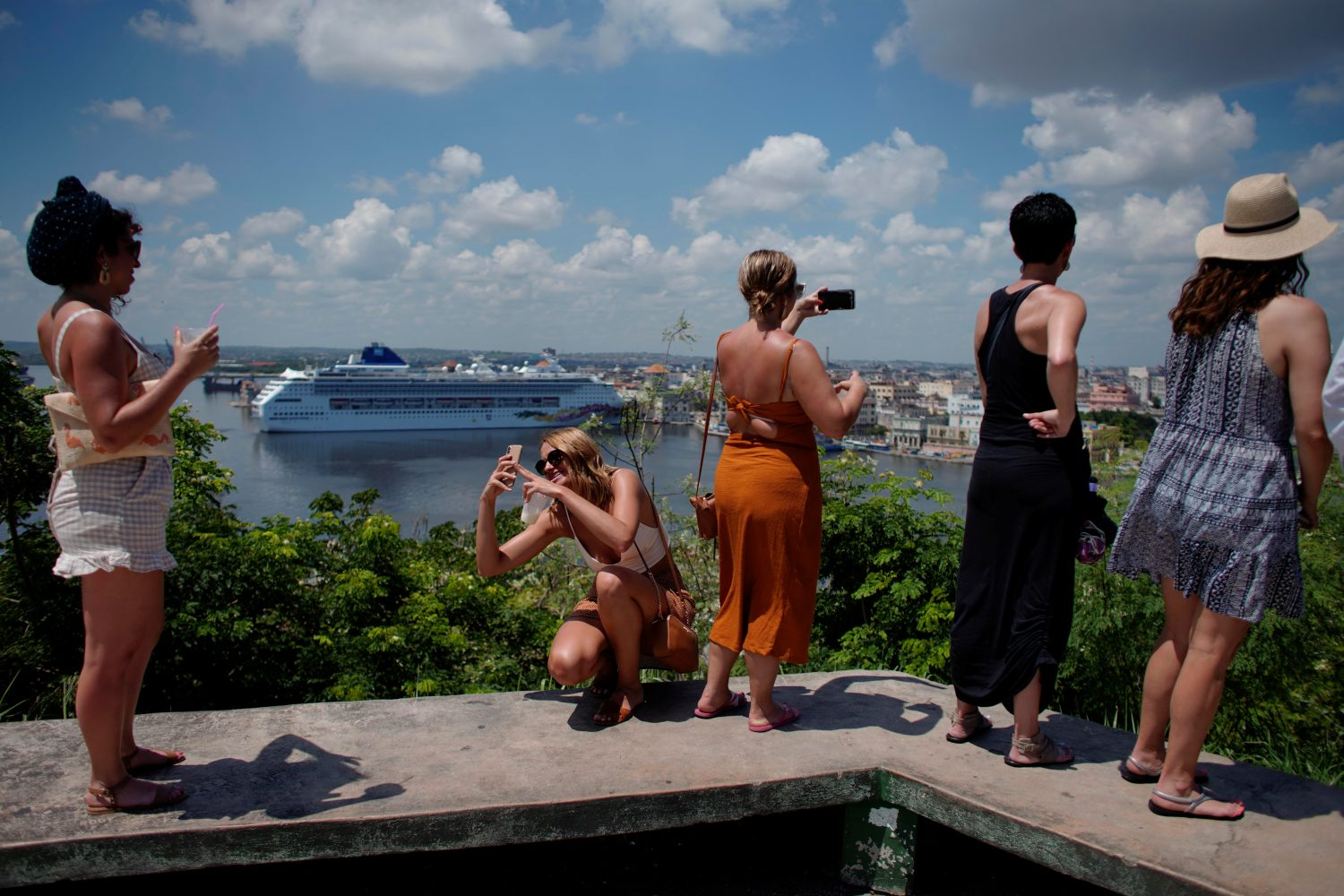 Tourists enjoy a view of the city in Havana, Cuba, June 4, 2019. REUTERS/Alexandre Meneghini