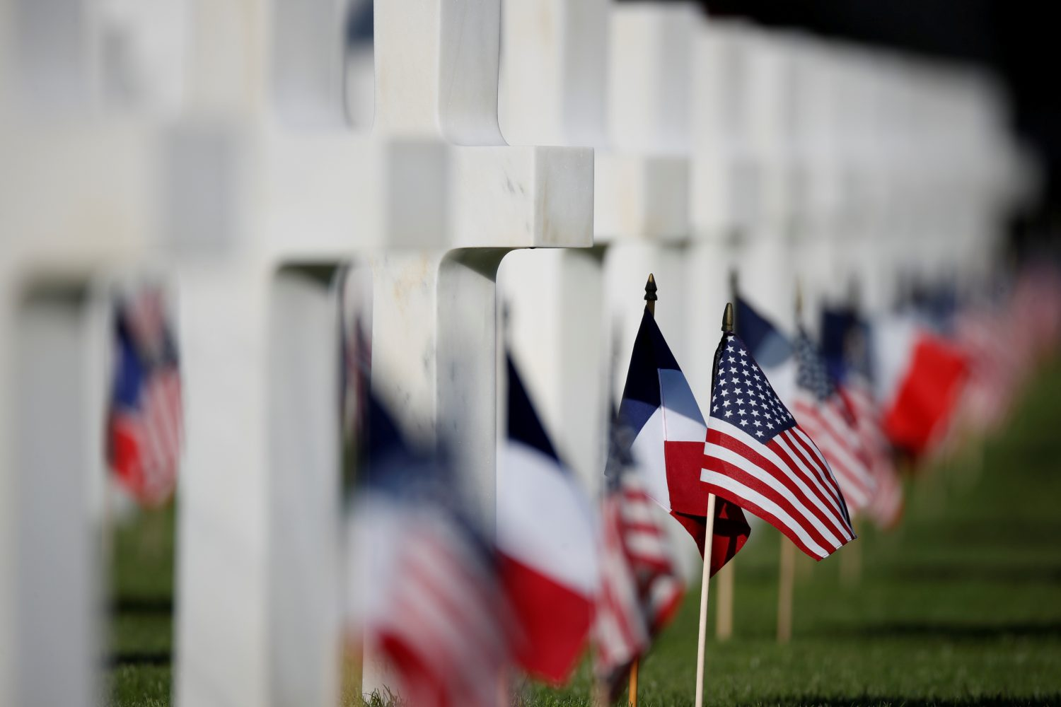 U.S. and French flags are seen in the American cemetery of Colleville-sur-Mer in Normandy, France, June 6, 2019. REUTERS/Christian Hartmann