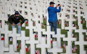 People take pictures in the American cemetery of Colleville-sur-Mer in Normandy ahead of the commemoration ceremony for the 75th anniversary of D-Day in Normandy, France, June 6, 2019. REUTERS/Christian Hartmann