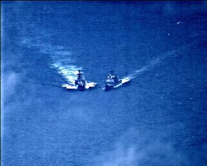 A surveillance photo shows the Russian naval destroyer Udaloy making what the U.S. Navy describes as an unsafe maneuver against the Ticonderoga-class guided-missile cruiser USS Chancellorsville in the Philippine Sea June 7, 2019. U.S. Navy/Handout via REUTERS.