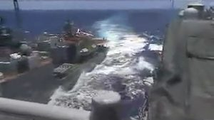 A screen grab from video shows the Russian naval destroyer Udaloy making what the U.S. Navy describes as an unsafe maneuver against the Ticonderoga-class guided-missile cruiser USS Chancellorsville in the Philippine Sea June 7, 2019. U.S. Navy/Handout via REUTERS.