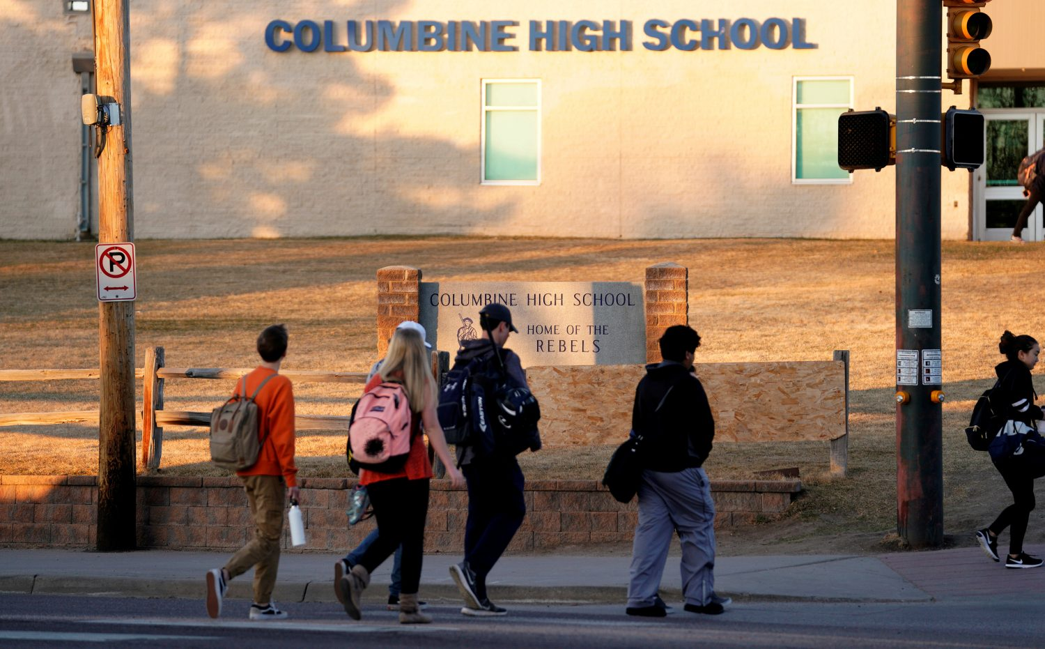 FILE PHOTO: Students arrive for class at Columbine High School before participating in a National School Walkout to honor the 17 students and staff members killed at Marjory Stoneman Douglas High School in Parkland, Florida, in Littleton, Colorado, U.S., March 14, 2018. REUTERS/Rick Wilking/File Photo