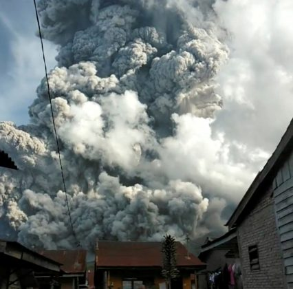 A volcanic ash cloud from Mount Sinabung hovers over Karo, North Sumatra, Indonesia June 9, 2019, in this still image taken from a social media video. Sinarisa Sitepu via REUTERS