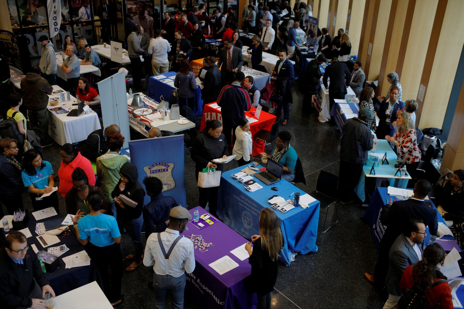 FILE PHOTO: Job seekers speak with potential employers at a City of Boston Neighborhood Career Fair on May Day in Boston, Massachusetts, U.S., May 1, 2017. REUTERS/Brian Snyder