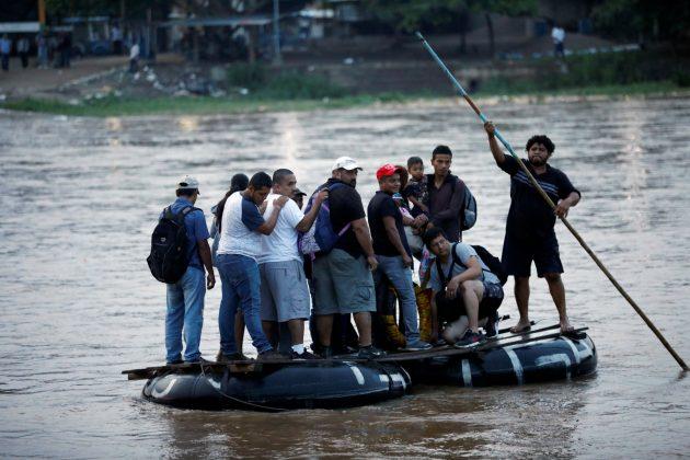 Central American migrants cross the Suchiate river on a raft from Tecun Uman, in Guatemala, to Ciudad Hidalgo, as seen from Ciudad Hidalgo, Mexico, June 10, 2019. REUTERS/Jose Cabezas