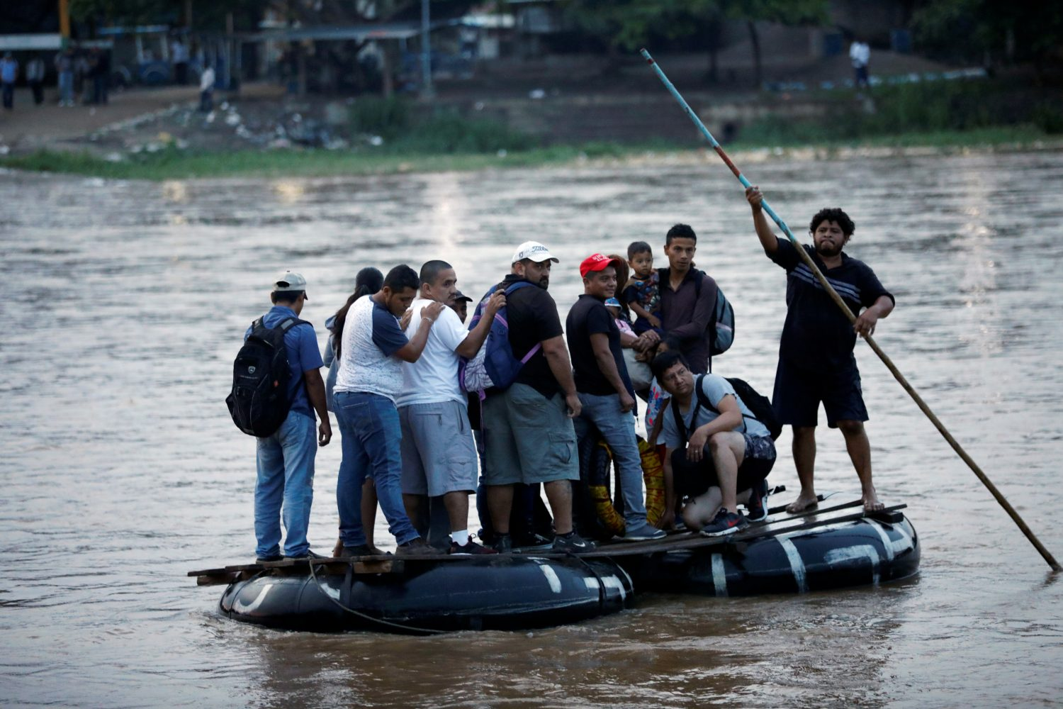 Central American migrants cross the Suchiate river on a raft from Tecun Uman, in Guatemala, to Ciudad Hidalgo, as seen from Ciudad Hidalgo, Mexico, June 10, 2019. REUTERS/Jose Cabezas