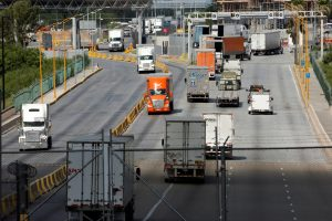 FILE PHOTO: Trucks cross the borderline into the U.S. and into Mexico at the World Trade Bridge, as seen from Laredo, Texas U.S., June 3, 2019. REUTERS/Carlos Jasso