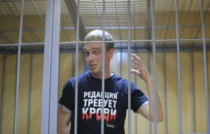 "A lawyer comforts Russian investigative journalist Ivan Golunov, who was detained by police and accused of drug offences, during a court hearing in Moscow, Russia June 8, 2019. The writing on the T-shirt reads ""Editorial desk demands blood"". REUTERS/Tatyana Makeyeva"