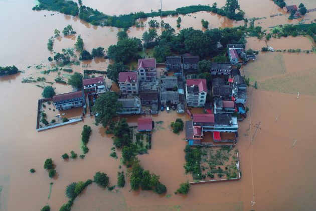 Residential houses and cars are seen submerged in floodwaters following heavy rainfall in Taihe county, Jian, Jiangxi province, China June 10, 2019. REUTERS/Stringer