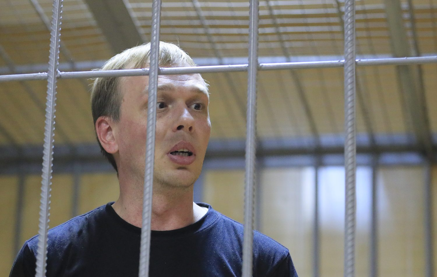 FILE PHOTO: Russian investigative journalist Ivan Golunov, who was detained by police and accused of drug offences, speaks inside a defendants' cage as he attends a court hearing in Moscow, Russia June 8, 2019. REUTERS/Tatyana Makeyeva