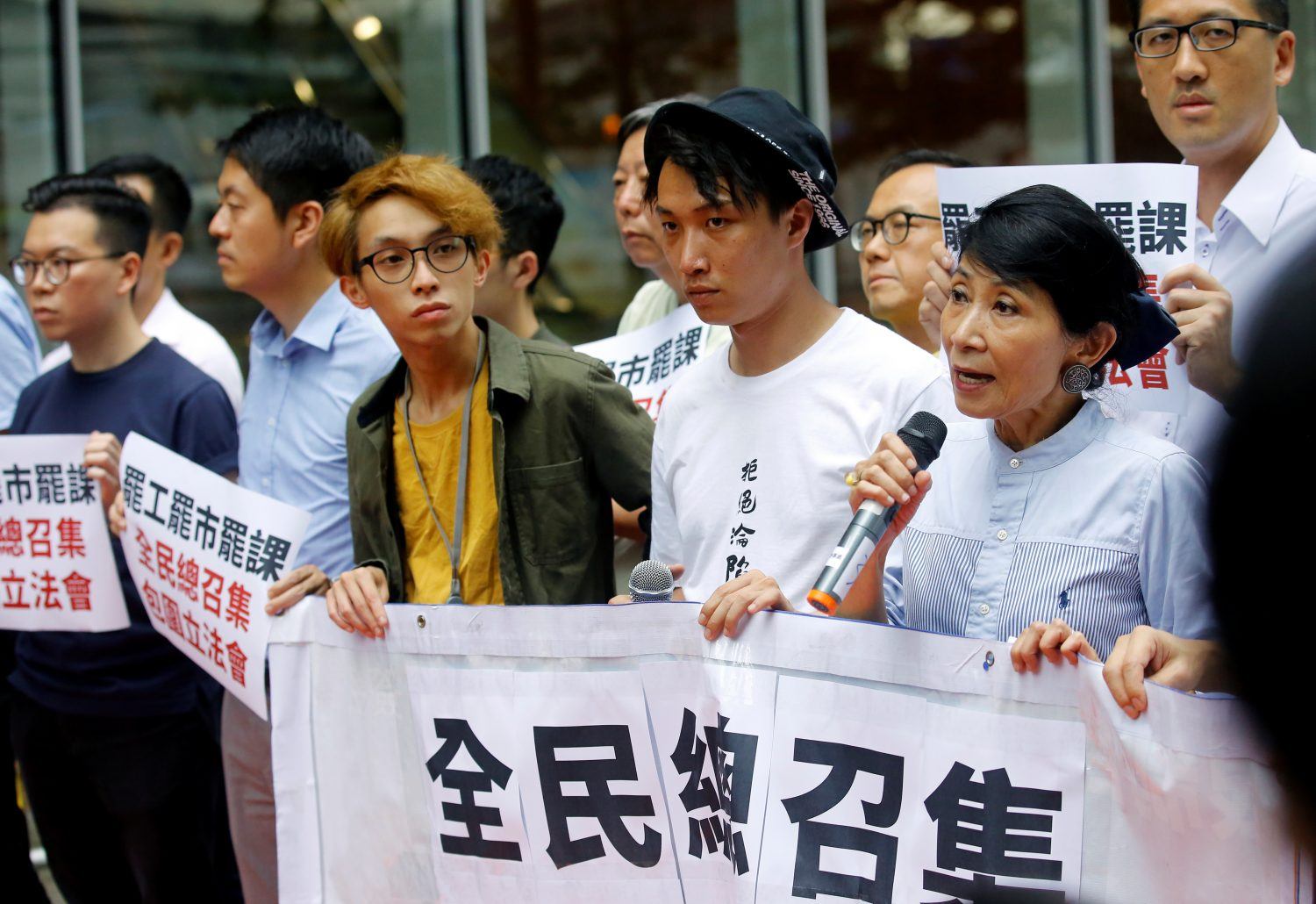 Hong Kong braced for strikes, transport go-slows and another mass demonstration in protest against a proposed extradition law that would allow people to be sent to China for trial, as the Chinese-ruled city's leader vowed defiance.