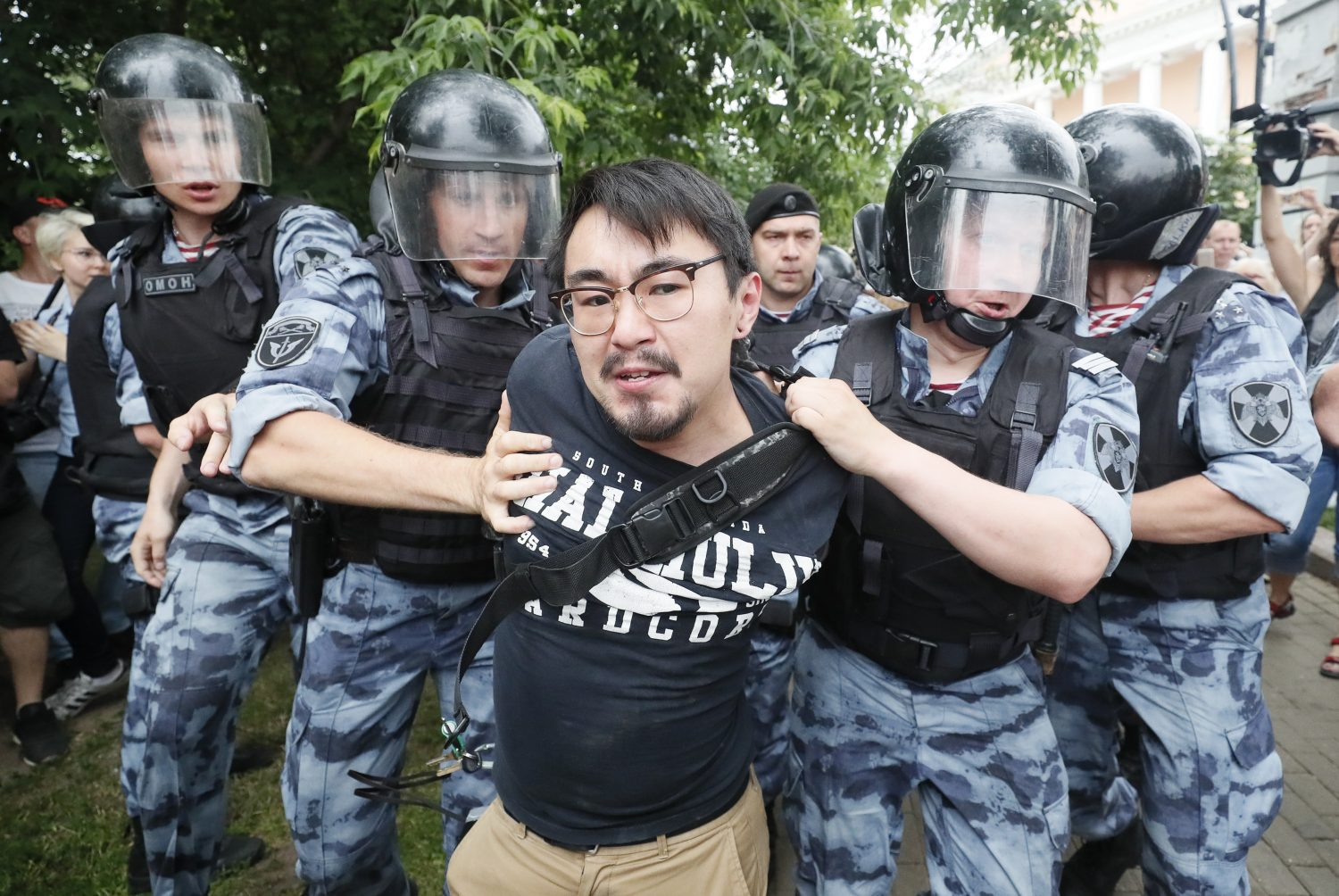 Law enforcement officers detain a participant of a rally in support of Russian investigative journalist Ivan Golunov, who was detained by police, accused of drug offences and later freed from house arrest, in Moscow, Russia June 12, 2019. REUTERS/Shamil Zhumatov