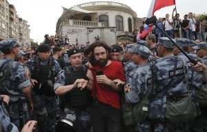A member of Russia's National Guard detains a man during a rally in support of Russian investigative journalist Ivan Golunov, who was detained by police, accused of drug offences and later freed from house arrest, in Moscow, Russia June 12, 2019. REUTERS/Maxim Shemetov