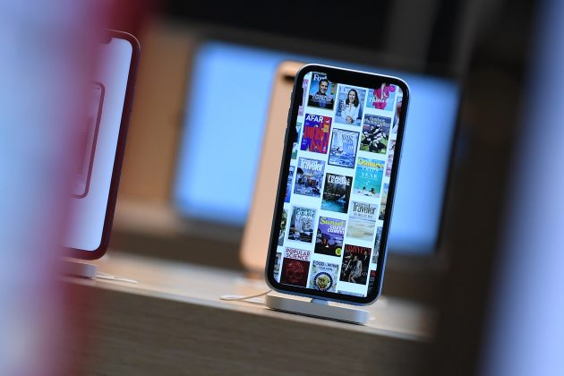 FILE PHOTO: Front pages of newspapers and magazines are displayed on an iPhone during the grand opening and media preview of the new Apple Carnegie Library store in Washington, U.S., May 9, 2019. REUTERS/Clodagh Kilcoyne/File Photo