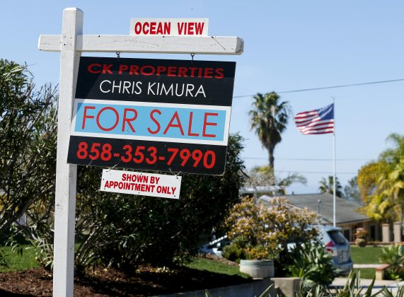 """FILE PHOTO: A """"For Sale"""" sign is seen outside a home in Cardiff, California February 22, 2016. REUTERS/Mike Blake"""