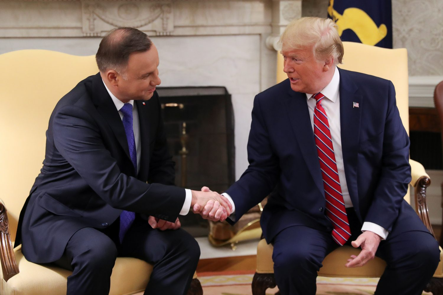 U.S. President Donald Trump greets Poland's President Andrzej Duda in the Oval Office of the White House in Washington, U.S., June 12, 2019. REUTERS/Leah Millis