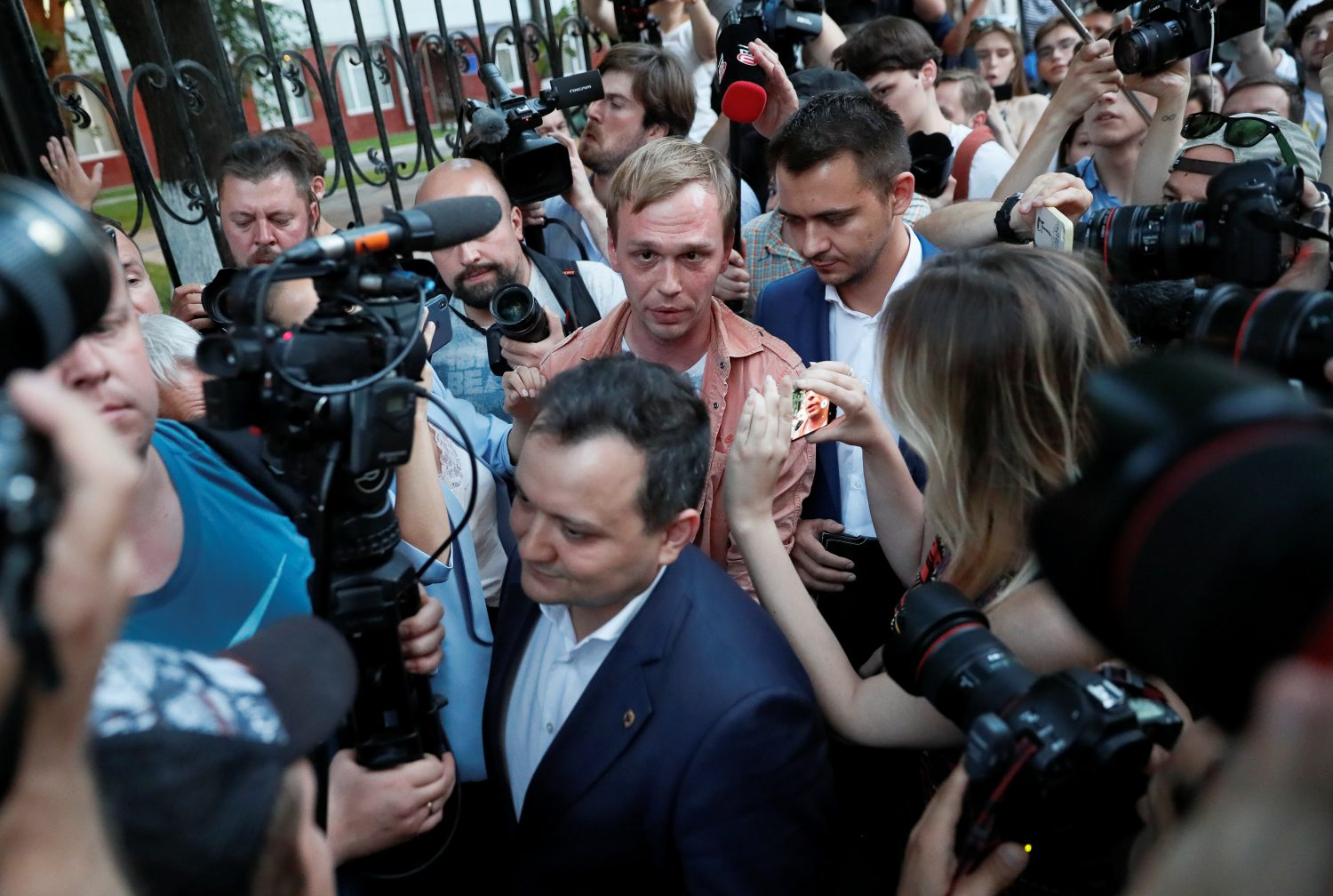 Russian journalist Ivan Golunov (C), who was freed from house arrest after police abruptly dropped drugs charges against him, reacts during a meeting with the media and his supporters outside the office of criminal investigations in Moscow, Russia June 11, 2019. REUTERS/Shamil Zhumatov
