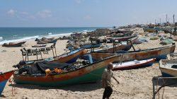 A Palestinian fisherman walks on a beach in the southern Gaza Strip June 13, 2019. REUTERS/Ibraheem Abu Mustafa