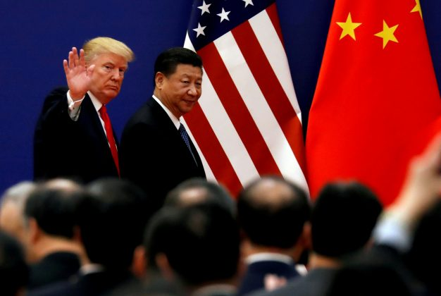 FILE PHOTO: FILE PHOTO: U.S. President Donald Trump and China's President Xi Jinping meet business leaders at the Great Hall of the People in Beijing, China, November 9, 2017. REUTERS/Damir Sagolj/File Photo - RC11ACBFE610