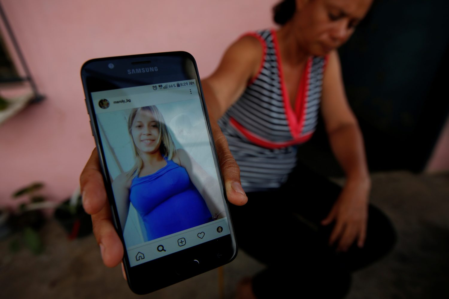 Carolina Gil shows a picture of her daughter Maroly Bastardo, an eight months pregnant woman who, along with her children, her husband's sister, uncle and father, disappeared in the Caribbean Sea after boarding a smuggler's boat during an attempt to cross from Venezuela to Trinidad and Tobago, at her home in El Tigre, Venezuela, June 4, 2019. REUTERS/Ivan Alvarado