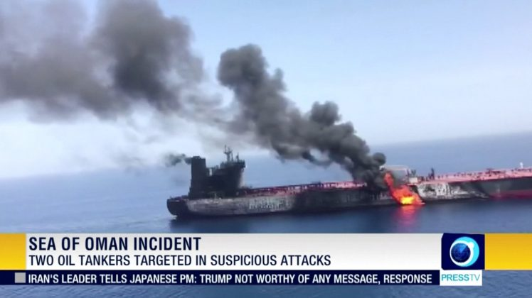 Still image taken from a video appears to show two tankers at sea, one of which has a large plume of dark smoke in the Gulf of Oman. PRESS TV/IRIB/via REUTERS