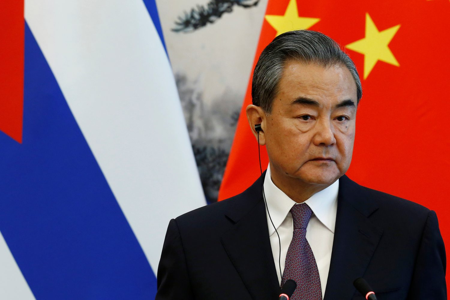 FILE PHOTO: Chinese Foreign Minister Wang Yi attends a news conference with Cuban Foreign Minister Bruno Rodriguez (not pictured) at Diaoyutai state guesthouse in Beijing, China May 29, 2019. REUTERS/Florence Lo