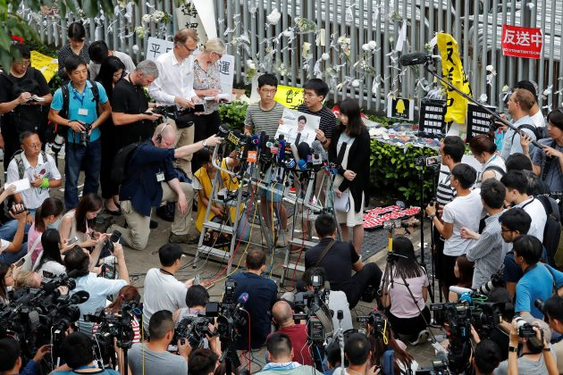 Pro-democracy activists Nathan Law, Joshua Wong and Agnes Chow attend a news conference regarding the proposed extradition bill, outside the Legislative Council building in Hong Kong, China June 18, 2019. REUTERS/Tyrone Siu