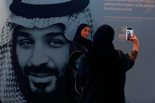 FILE PHOTO: Participants take photos next to a picture of Saudi Crown Prince Mohammed bin Salman during the Misk Global Forum in Riyadh, Saudi Arabia, November 14, 2018. REUTERS/Faisal Al Nasser/File Photo