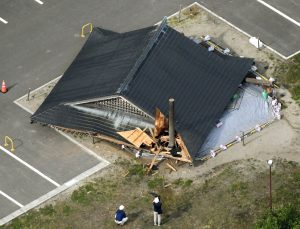 A collapsed wooden roof of a sumo wrestling ring caused by an earthquake is seen at the Oizumi Elementary School in Tsuruoka, Yamagata prefecture, Japan June 19, 2019, in this photo taken by Kyodo. Mandatory credit Kyodo/via REUTERS ATTENTION EDITORS - THIS IMAGE WAS PROVIDED BY A THIRD PARTY. MANDATORY CREDIT. JAPAN OUT. NO COMMERCIAL OR EDITORIAL SALES IN JAPAN.