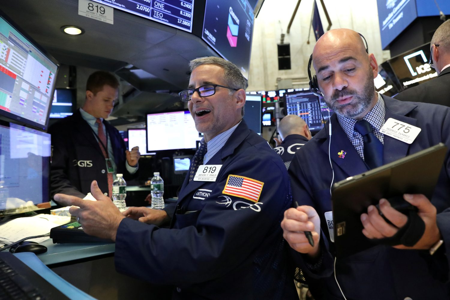 FILE PHOTO: Traders work on the floor at the New York Stock Exchange (NYSE) in New York, U.S., June 19, 2019. REUTERS/Brendan McDermid/File Photo