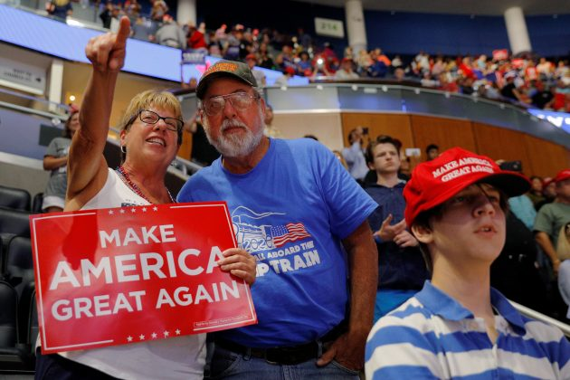 "John Lenges, 65, a resident of Pinellas County, who changed parties to vote Republican in 2016, and his sister Jeanne Coffin talk at the conclusion of U.S. President Donald Trump's re-election campaign kick off rally in Orlando, Florida, U.S., June 18, 2019. I'd like to give him at least another four years."" Before Trump announced his presidential bid, Lenges was a Democrat. He mostly tuned out politics and had never voted for a Republican president. ""It was a wakeup call,"" he said. ""Our country needed a turn."" Lenges' framed ticket to Trump's inauguration hangs on a home office wall once dedicated to NASCAR. REUTERS/Brian Snyder"