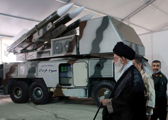 """Iran's Supreme Leader Ayatollah Ali Khamenei is seen near a """"3 Khordad"""" system which is said to had been used to shoot down a U.S. military drone, according to news agency Fars, in this undated handout picture. Fars news/Handout via REUTERS ATTENTION EDITORS - THIS IMAGE WAS PROVIDED BY A THIRD PARTY. NO RESALES. NO ARCHIVES. REUTERS IS UNABLE TO INDEPENDENTLY VERIFY THIS IMAGE."""