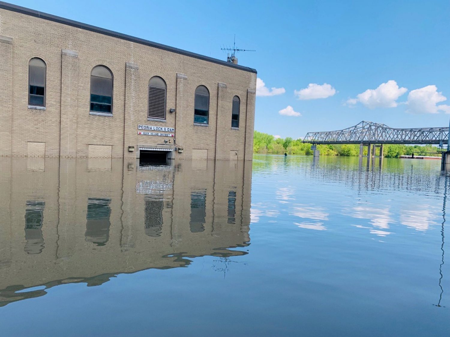FILE PHOTO: The Peoria Lock and Dam building is shown surrounded by flood waters of the Mississippi River in Peoria, Illinois, U.S., May 16, 2019. U.S. Army Corps of Engineers/Rock Island District/Handout via REUTERS
