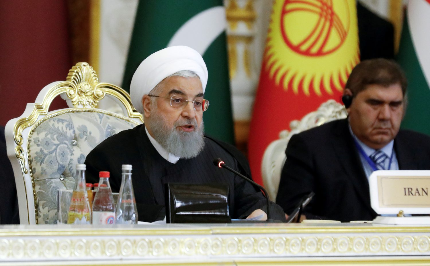 FILE PHOTO: Iranian President Hassan Rouhani delivers a speech at the Conference on Interaction and Confidence-Building Measures in Asia (CICA) in Dushanbe, Tajikistan June 15, 2019. REUTERS/Mukhtar Kholdorbekov/File Photo