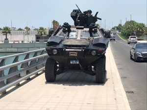 "Bahraini armoured vehicle takes up position on bridge leading to Manama's Four Seasons hotel for first day of U.S.-hosted ""Peace to Prosperity"" conference, in Manama, Bahrain, June 25, 2019. REUTERS/Matt Spetalnick"