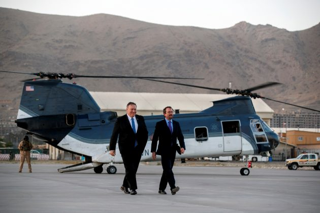 Secretary of State Mike Pompeo walks from a helicopter with U.S. Ambassador to Afghanistan John Bass, as Pompeo returns to his plane after an unannounced visit to Kabul, Afghanistan, June 25, 2019. Jacquelyn Martin/Pool via REUTERS
