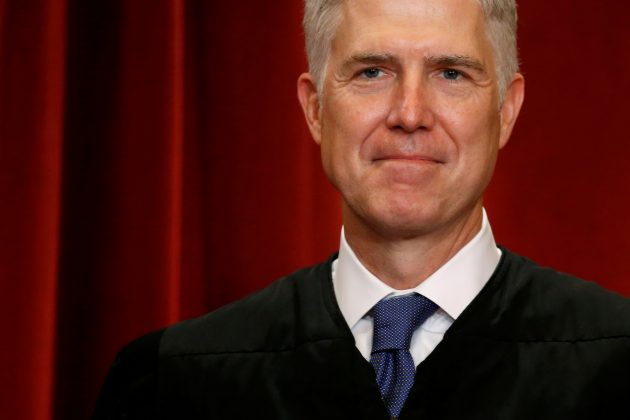 FILE PHOTO: U.S. Supreme Court Justice Neil Gorsuch participates in taking a new family photo with his fellow justices at the Supreme Court building in Washington, D.C., U.S., June 1, 2017. REUTERS/Jonathan Ernst/File Photo