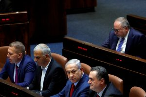 FILE PHOTO: Israeli Prime Minister Benjamin Netanyahu sits with his ministers and former Israel's Defence Minister Avigdor Lieberman at the plenum at the Knesset, Israel's parliament, in Jerusalem May 29, 2019. REUTERS/Ronen Zvulun
