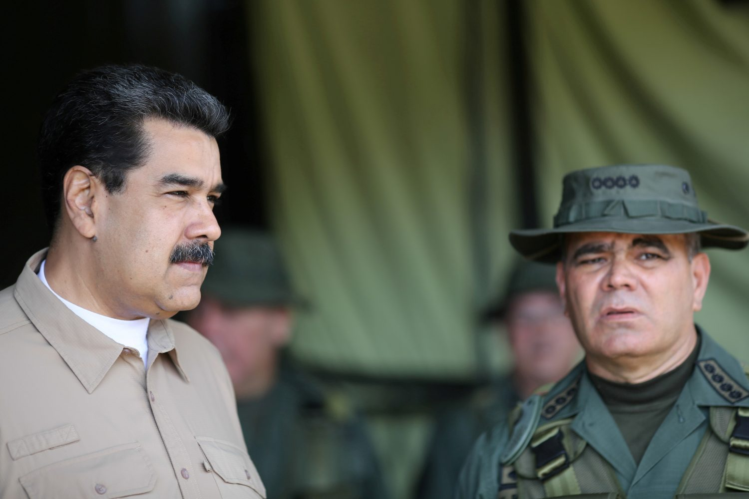 FILE PHOTO: Venezuela's President Nicolas Maduro and Defense Minister Vladimir Padrino speak during a meeting with military commanders, in Caracas, Venezuela June 3, 2019. Miraflores Palace/Handout via REUTERS/File Photo