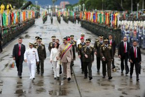 FILE PHOTO: Venezuela's President Nicolas Maduro arrives for a military parade to celebrate the 196th anniversary of the Battle of Carabobo, next to his wife Cilia Flores and Venezuela's Defense Minister Vladimir Padrino Lopez, in Caracas, Venezuela June 24, 2017. Miraflores Palace/Handout via REUTERS/File Photo